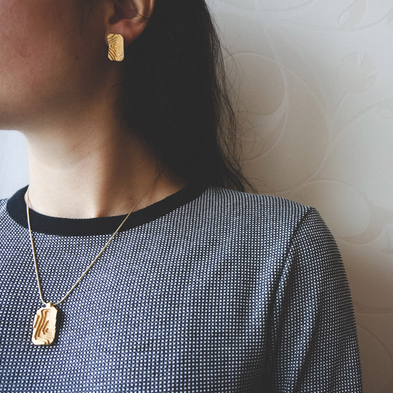 Pit relief necklace, 3D printed steel/gold plated